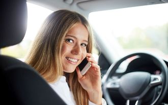 Business woman calling in car